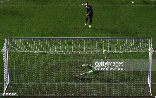Fulham's Clint Dempsey takes his penalty but has it saved by Swansea goalkeeper Michel Vorm during the Barclays Premier League match at the Liberty...