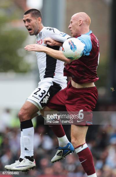 Fulham's Clinton Dempsey goes up for the ball against Aston Villa's James Collins