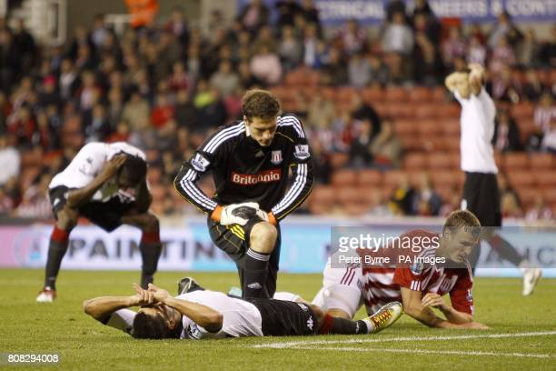 Fulham's Clinton Dempsey lies dejected on the floor after his shot on goal goes over the bar after Stoke City goalkeeper Asmir Begovic dropped the...
