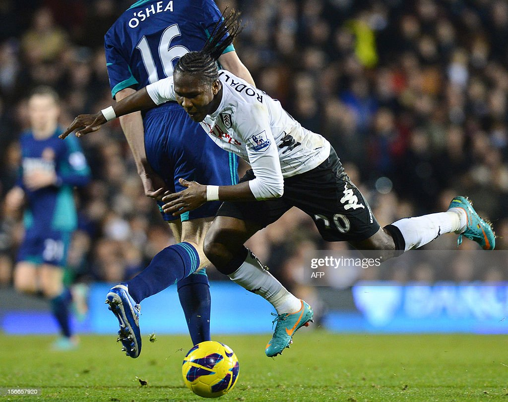 """Fulham's Colombian forward Hugo Rodellega (R) vies for the ball with Sunderland's Irish defender John O'Shea (L) during the English Premier League football match between Fulham and Sunderland at Craven Cottage in London on November 18, 2012. USE. No use with unauthorized audio, video, data, fixture lists, club/league logos or """"live"""" services. Online in-match use limited to 45 images, no video emulation. No use in betting, games or single club/league/player publications."""