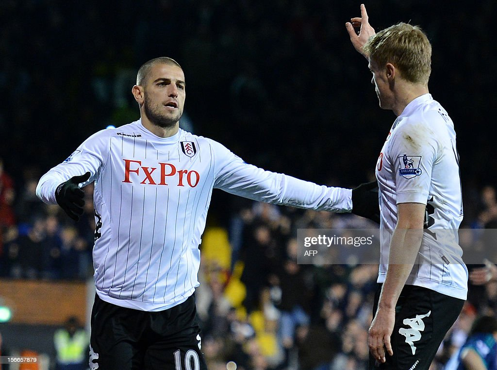 """Fulham's Croatian forward Mladen Petric (L) celebrates with Fulham's Irish midfielder Damien Duff (R) after scoring a goal during the English Premier League football match between Fulham and Sunderland at Craven Cottage in London on November 18, 2012. USE. No use with unauthorized audio, video, data, fixture lists, club/league logos or """"live"""" services. Online in-match use limited to 45 images, no video emulation. No use in betting, games or single club/league/player publications."""