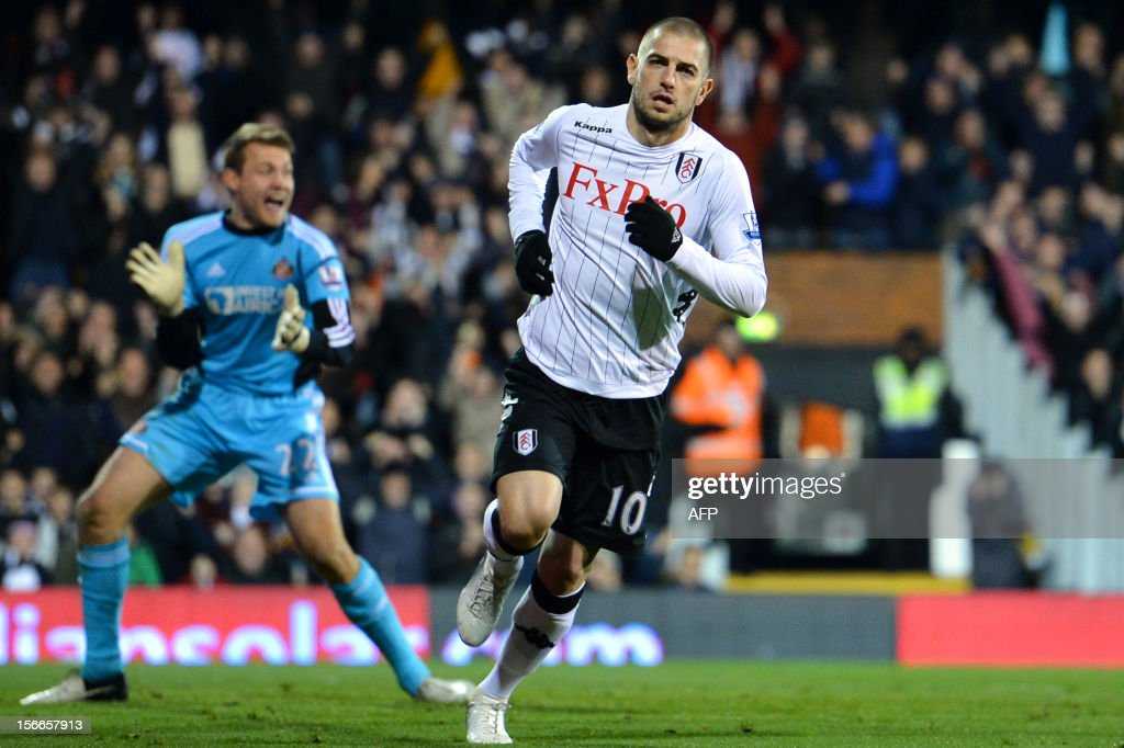 """Fulham's Croatian forward Mladen Petric (R) reacts after scoring a goal during the English Premier League football match between Fulham and Sunderland at Craven Cottage in London on November 18, 2012. USE. No use with unauthorized audio, video, data, fixture lists, club/league logos or """"live"""" services. Online in-match use limited to 45 images, no video emulation. No use in betting, games or single club/league/player publications."""