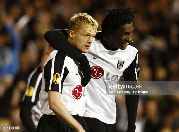 Fulham's Damien Duff celebrates scoring their second goal with team mate Dickson Etuhu