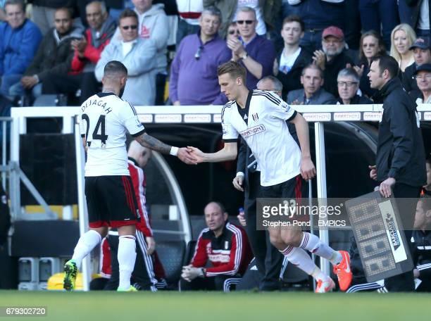 Fulham's Dan Burn is substituted on for Ashkan Dejagah