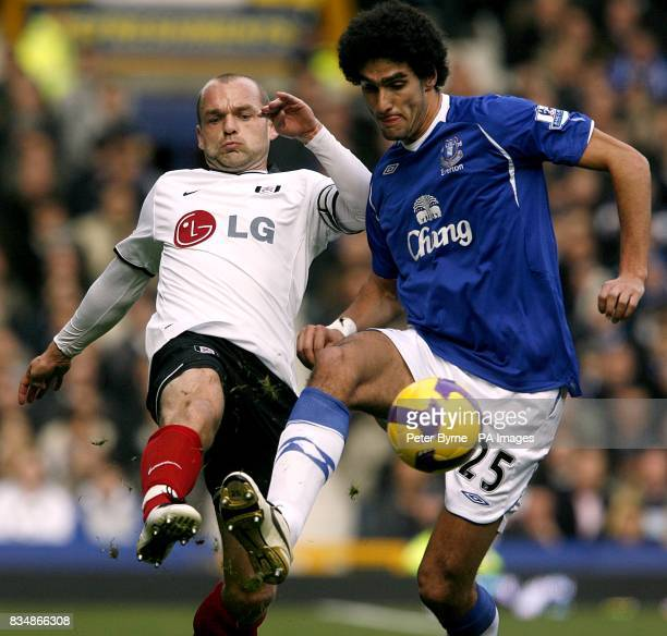 Fulham's Danny Murphy and Everton's Marouane Fellaini battle for the ball