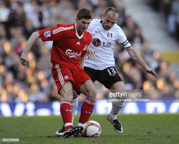 Fulham's Danny Murphy and Liverpool's Steven Gerrard battle for the ball