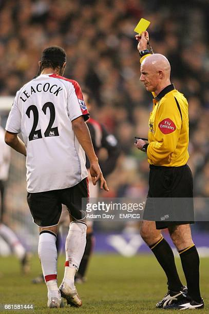 Fulham's Dean Leacock is booked by referee Dermot Gallagher