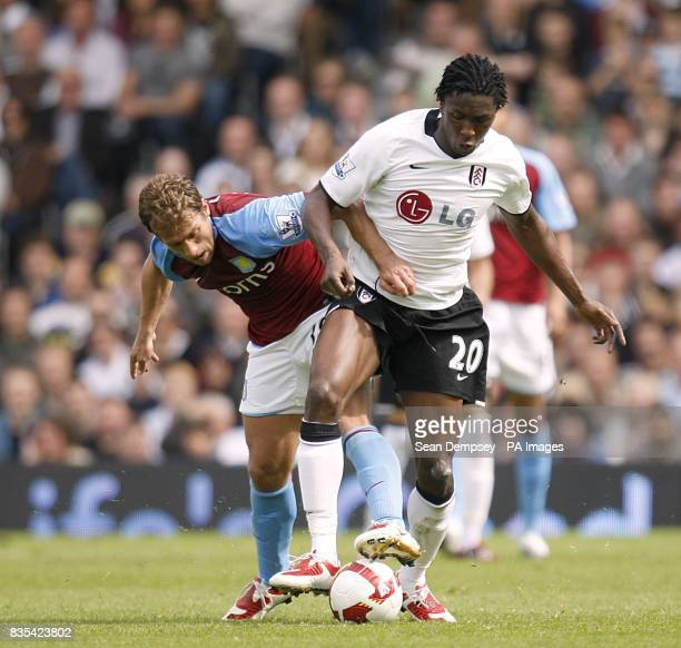 Fulham's Dickson Etuhu and Aston Villa's Stiliyan Petrov battle for the ball