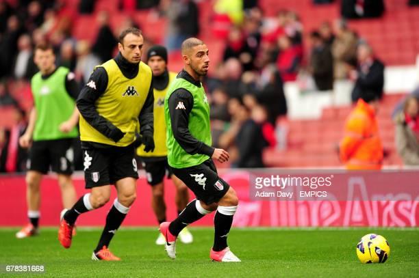 Fulham's Dimitar Berbatov and teammate Ashkan Dejagah during warmup