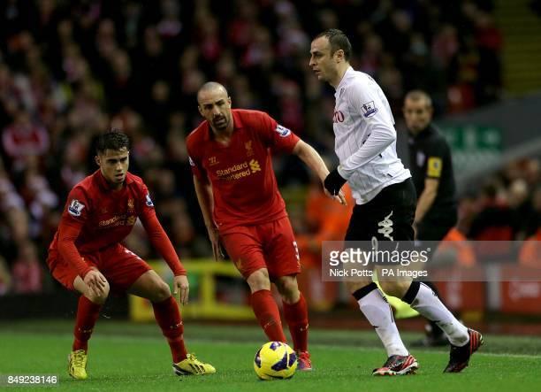 Fulham's Dimitar Berbatov in action with Liverpool's Sanchez Jose Enrique and Suso