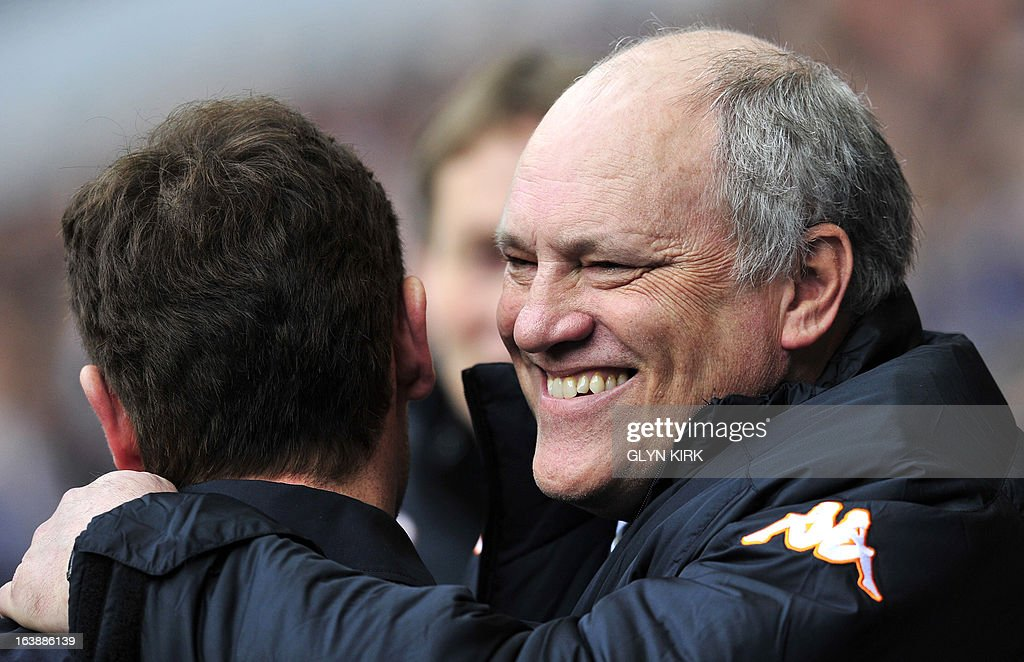 "Fulham's Dutch manager Martin Jol Hugs Tottenham Hotspur's Portuguese manager Andre Villas-Boas (L) before the start of the English Premier League football match between Tottenham Hotspur and Fulham at White Hart Lane in north London on March 17, 2013. USE. No use with unauthorized audio, video, data, fixture lists, club/league logos or ""live"" services. Online in-match use limited to 45 images, no video emulation. No use in betting, games or single club/league/player publications"