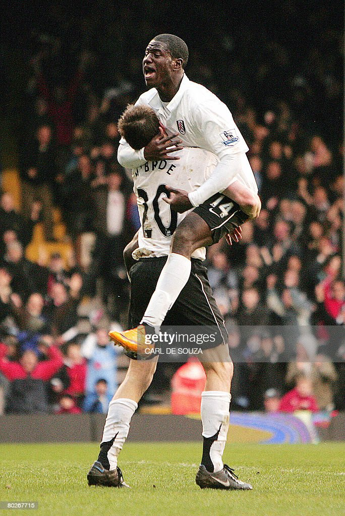 Fulham's Eddie Johnson (Up) and captain Brian McBride celebrate McBride's goal during their Premiership match against Everton at Fulham's Craven Cottage Stadium on March 16, 2008. AFP PHOTO/CARL DE SOUZA --- Mobile and website use of domestic English football pictures are subject to obtaining a Photographic End User Licence from Football DataCo Ltd Tel : +44 (0) 207 864 9121 or e-mail accreditations@football-dataco.com - applies to Premier and Football League