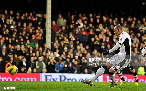 Fulham's English striker Bobby Zamora scores their fourth goal from a penalty spot during the English Premier League football match between Fulham...