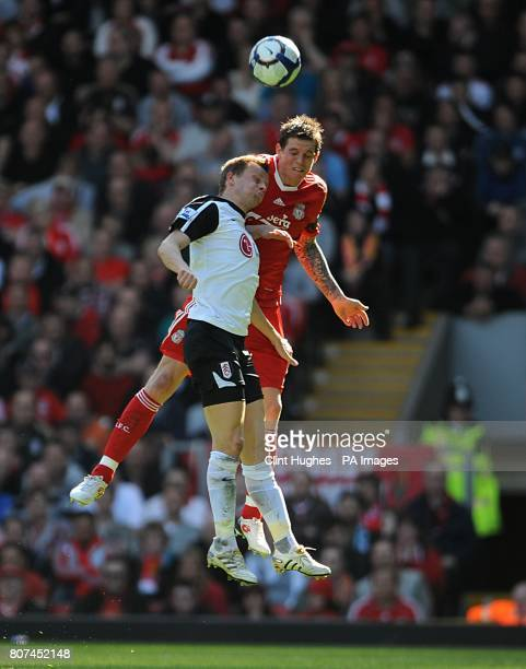 Fulham's Erik Nevland and Liverpool's Daniel Agger battle for the ball