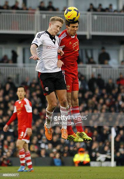 Fulham's German striker Lewis Holtby vies with Southampton's English midfielder Jack Cork defender Nathaniel Clyne during the English Premier League...