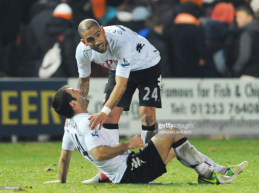 "Fulham's Greek midfielder Giorgos Karagounis (top) and Fulham's Iranian midfielder Ashkan Dejagah (bottom) embrace at the end of their extra-time win during the English FA Cup third round replay football match between Blackpool and Fulham at Bloomfield Road in Blackpool, northwest England, on January 15, 2013. USE. No use with unauthorized audio, video, data, fixture lists, club/league logos or ""live"" services. Online in-match use limited to 45 images, no video emulation. No use in betting, games or single club/league/player publications."