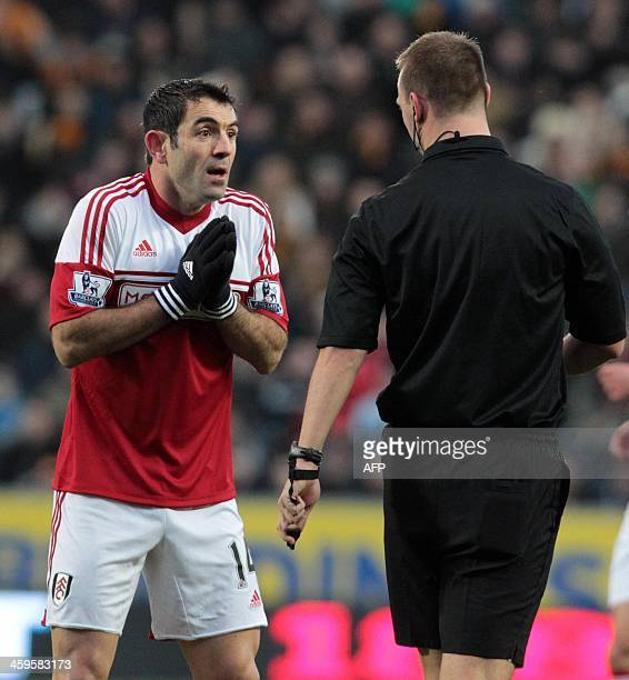Fulham's Greek midfielder Giorgos Karagounis pleads with referee Robert Madley during the English Premier League football match between Hull City and...