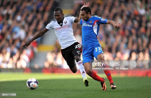 Fulham's Hugo Rodallega and Hull City's Ahmed Elmohamady battle for the ball
