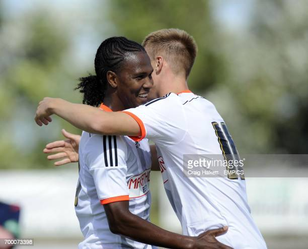 Fulham's Hugo Rodallega celebrates with team mate Cauley Woodrow