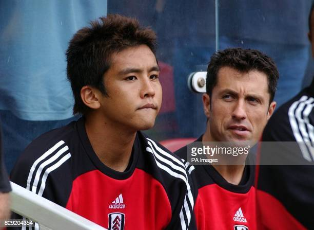 Fulham's Japanese star Junichi Inamoto sits the bench before coming on against Middlesbrough during their FA Barclaycard Premiership match at...