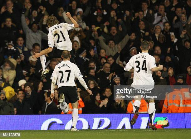 Fulham's Jimmy Bullard jumps in the air celebrating after scoring from a free kick to give Fulham the lead