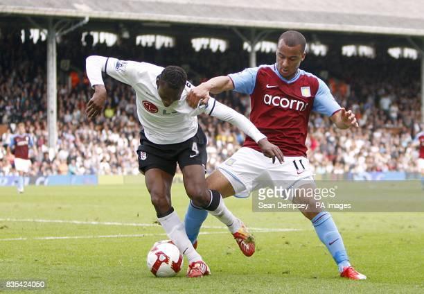 Fulham's John Pantsil and Aston Villa's Gabriel Agbonlahor battle for the ball