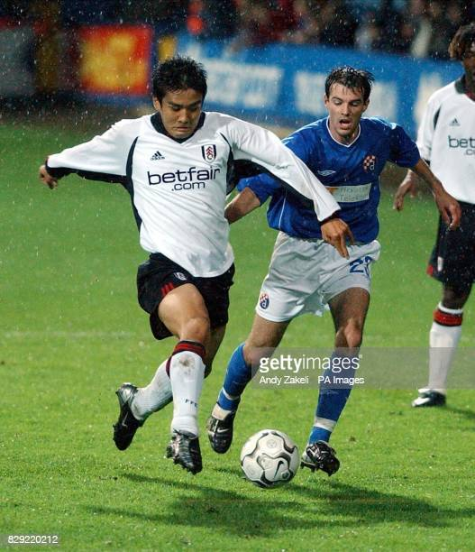 Fulhams Junichi Inamoto avoids the attention of Zagreb's Mihael Mikic during their UEFA Cup second round match at Loftus Road Stadium THIS PICTURE...