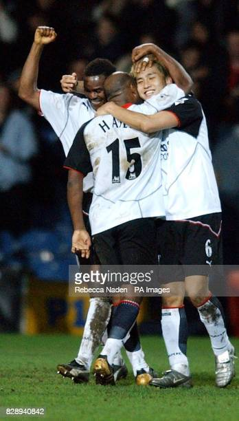 Fulham's Junichi Inamoto celebrates with teammates after scoring the opening goal against Everton during the FA Cup fourth round replay match at...