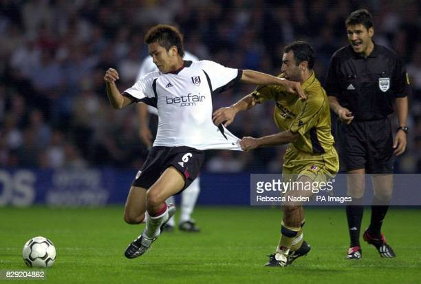 Fulham's Junichi Inamoto has his shirt pulled by Bologna's Leonardo Colucci as Swiss referee Massimo Busacca watches on during the Intertoto Cup...
