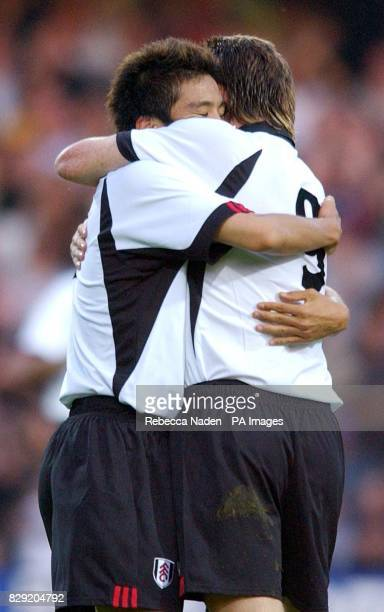 Fulham's Junichi Inamoto hugs teammate Facundo Sava after scoring against Bologna during the Intertoto Cup Final secondleg game at Loftus Road London...