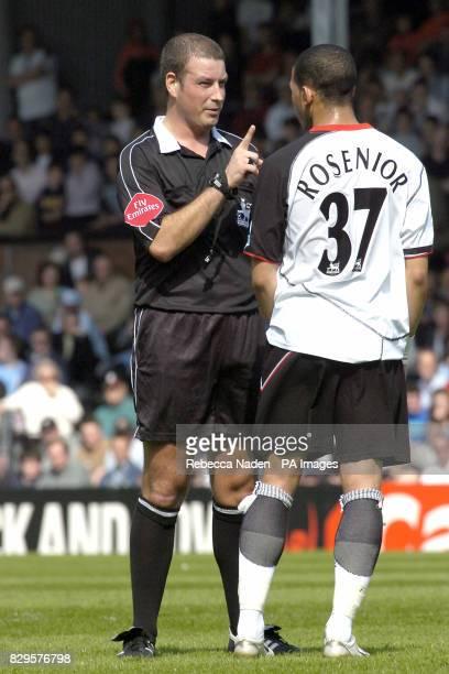 Fulham's Liam Rosenior gets a warning from referee Mark Clattenburg