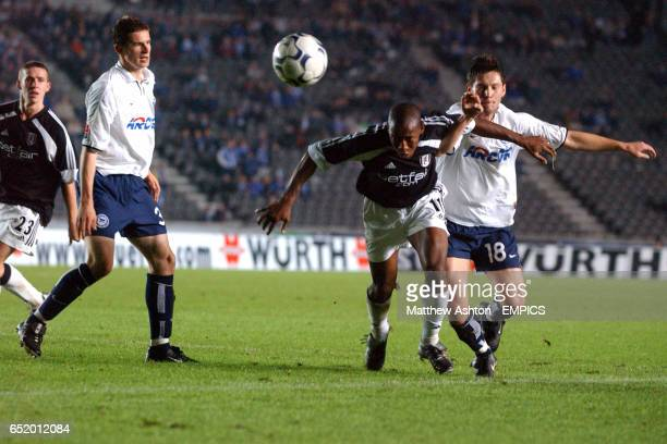 Fulham's Luis Boa Morte and Pal Dardai of Hertha Berlin chase the ball