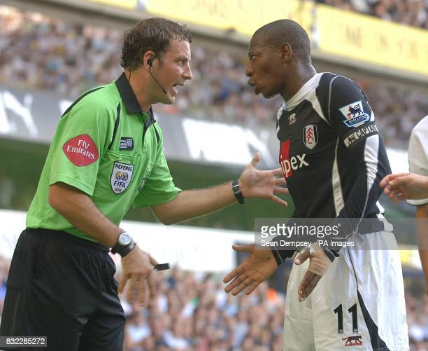 Fulham's Luis Boa Morte argue's with Referee Mark Clattenburg after a foul on Tottenham's Jermaine Jenas