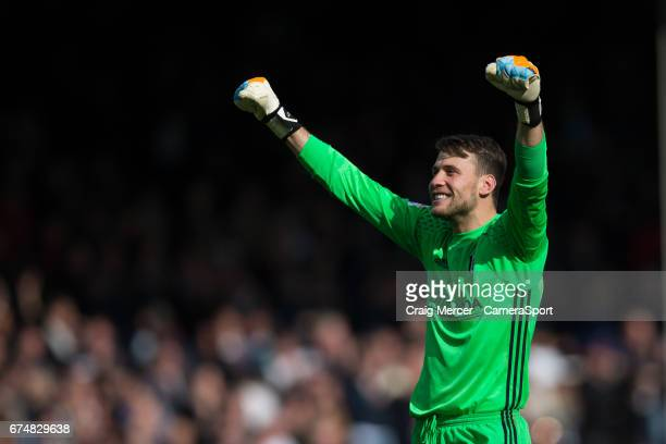 Fulham's Marcus Bettinelli celebrates at full time of the Sky Bet Championship match between Fulham and Brentford at Craven Cottage on April 29 2017...