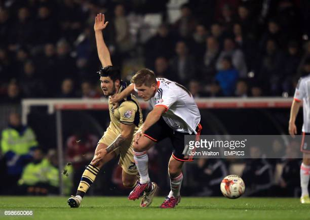 Fulham's Michael Turner battles for possession of the ball with Leeds United's Charlie Taylor