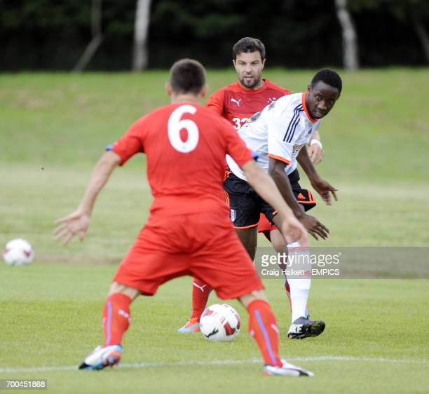 Fulham's Moussa Dembele playing in the friendly against Rangers FC