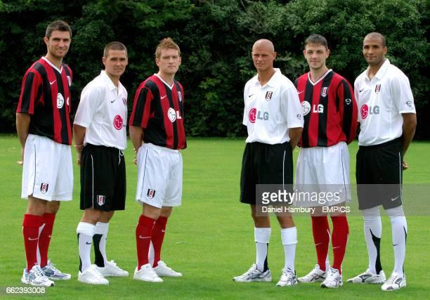 Fulham's new signings LRAaron Hughes David Healy Steven Davis Paul Konchesky Chris Baird and Diomansy Kamara pose in the new kit