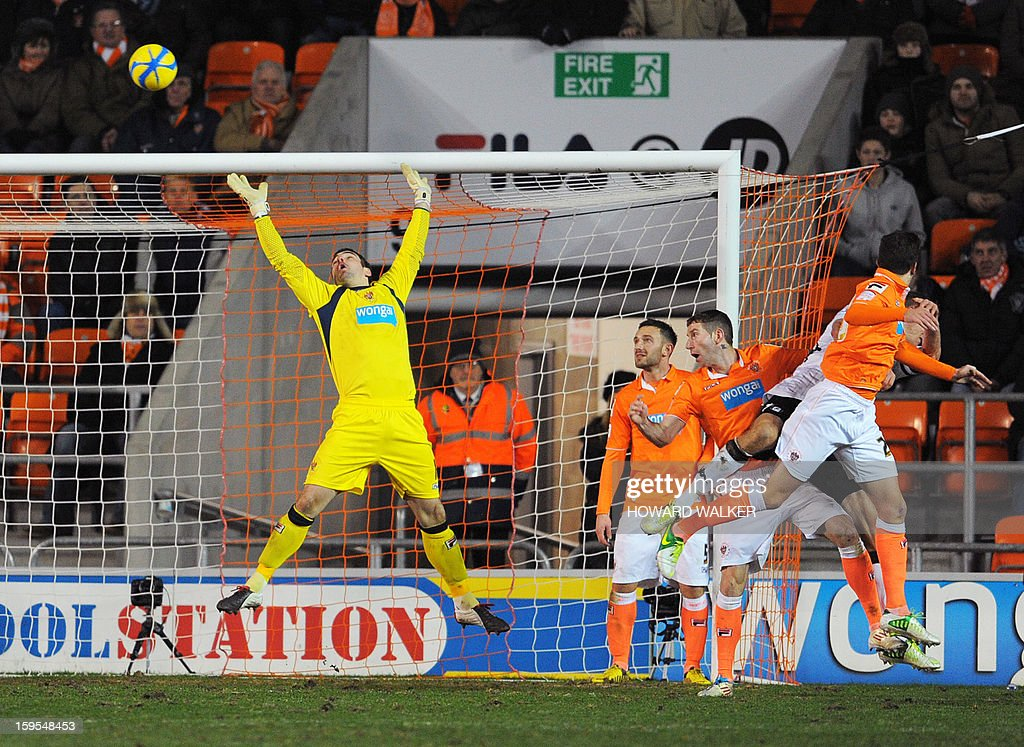 "Fulham's Norwegian defender Brede Hangeland (R) rises above the defenders to head over Blackpool keeper Matthew Gilks to score Fulham's winning goal in extra time during the English FA Cup third round replay football match between Blackpool and Fulham at Bloomfield Road in Blackpool, northwest England, on January 15, 2013. USE. No use with unauthorized audio, video, data, fixture lists, club/league logos or ""live"" services. Online in-match use limited to 45 images, no video emulation. No use in betting, games or single club/league/player publications."