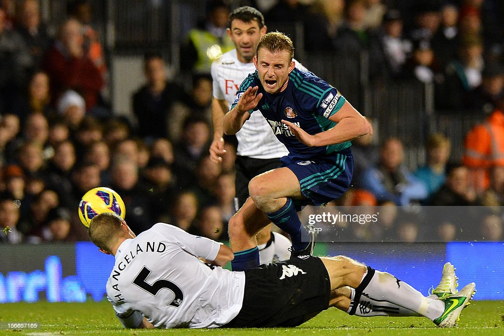 """Fulham's Norwegian defender Brede Hangeland (L) tackles Sunderland's English midfielder Lee Cattermole (R) during the English Premier League football match between Fulham and Sunderland at Craven Cottage in London on November 18, 2012. USE. No use with unauthorized audio, video, data, fixture lists, club/league logos or """"live"""" services. Online in-match use limited to 45 images, no video emulation. No use in betting, games or single club/league/player publications."""