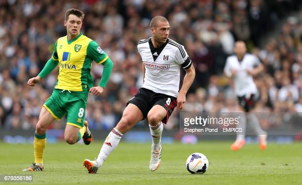 Fulham's Pajtim Kasami and Norwich City's Jonny Howson compete for the ball