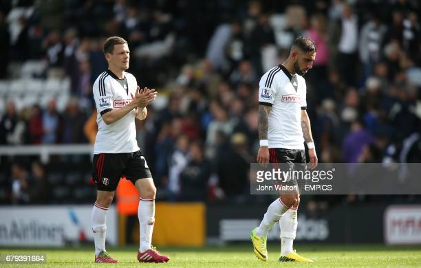 Fulham's Sascha Riether and Ashkan Dejagah dejected after the final whistle