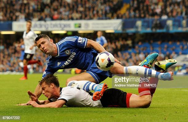 Fulham's Scott Parker and Chelsea's Gary Cahill battle for the ball