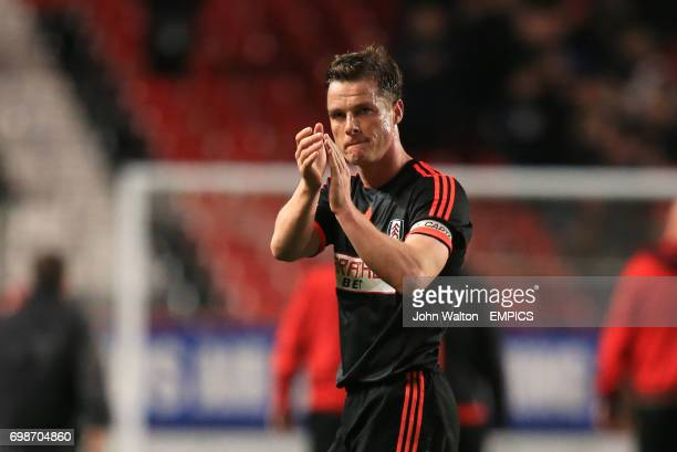 Fulham's Scott Parker applauds the away fans at the end of the match