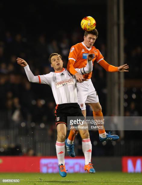 Fulham's Scott Parker battles for possession of the ball in the air with Blackpool's John Lundstram