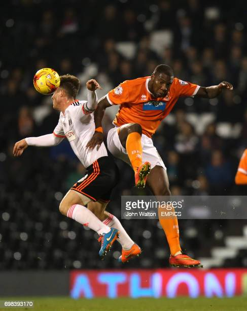 Fulham's Scott Parker battles for possession of the ball in the air with Blackpool's Ishmael Miller