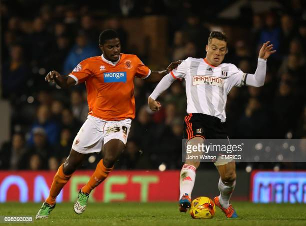 Fulham's Scott Parker battles for possession of the ball with Blackpool's Andre Blackman