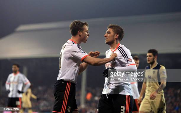 Fulham's Scott Parker pushes his teammate Kostas Stafylidis away before he is sent off for a second yellow card