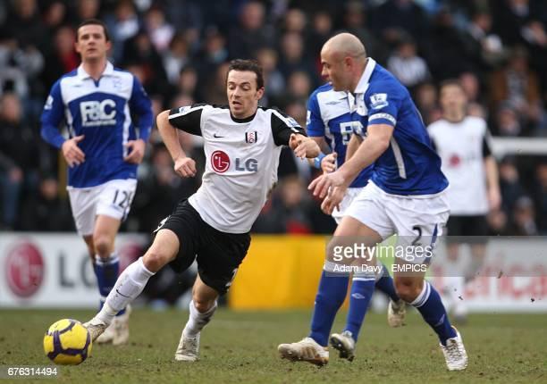 Fulham's Simon Davies and Birmingham City's Stephen Carr battle for the ball