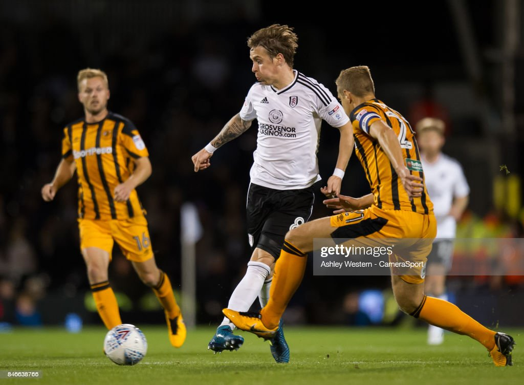 Fulham's Stefan Johansen holds off the challenge from Hull City's Michael Dawson during the Sky Bet Championship match between Fulham and Hull City at Craven Cottage on September 13, 2017 in London, England.