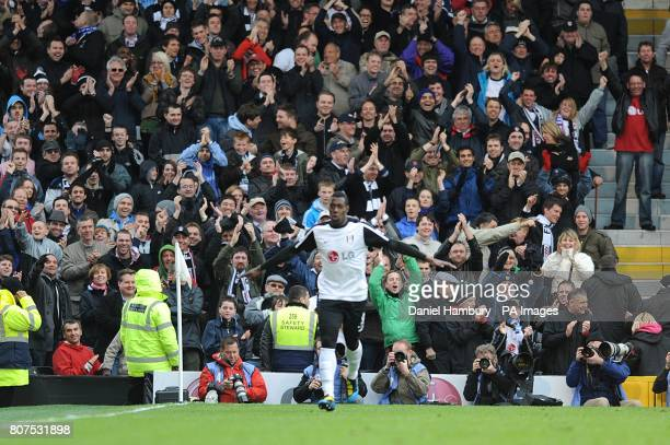 Fulham's Stefano Okaka celebrates scoring their third goal of the game in front of the Fulham fans